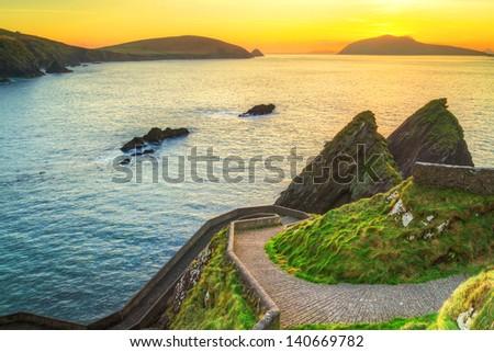 Sunset over Dunquin bay on Dingle Peninsula, Co.Kerry, Ireland - stock photo