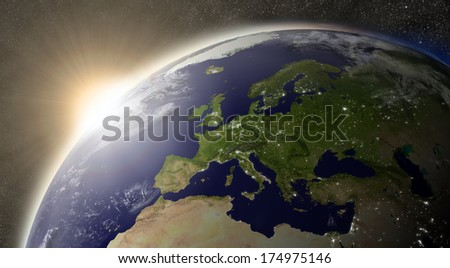 Sunset over Europe region on planet Earth viewed from space with Sun and stars in the background. Elements of this image furnished by NASA.