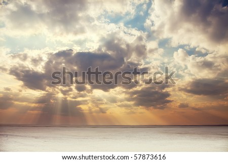 sunset over frozen lake - stock photo