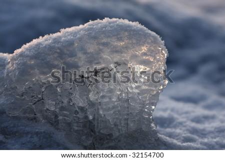 Sunset over frozen lake in winter, Finland, frozen detail - stock photo