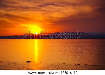 Sunset over Garda lake in Italy. - stock photo