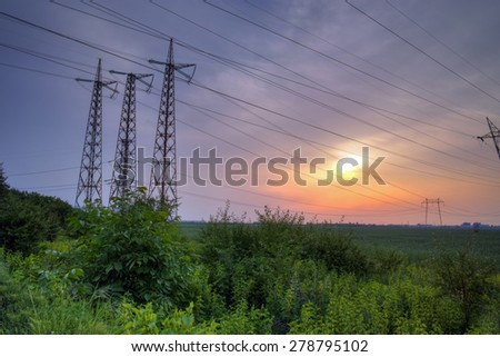 Sunset over High-voltage power lines  in the land around Plovdiv