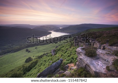 sunset over hills with lovely colours at bamford edge in the peak district - stock photo