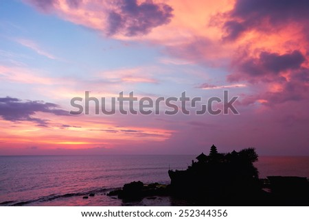 sunset over hindu temple Tanah Lot, Bali, Indonesia - stock photo