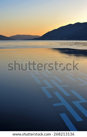 Sunset over infinity pool - stock photo