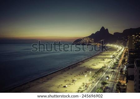 Sunset over Ipanema Beach in Rio de Janeiro, Brazil - stock photo