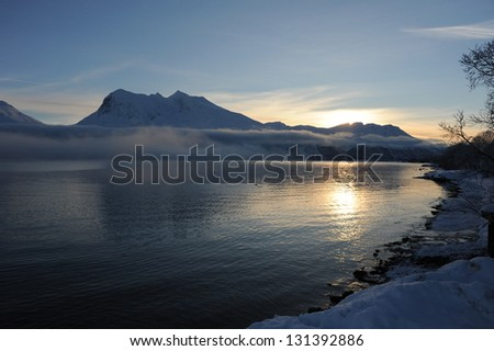 Sunset over Kval�¸ya, Norway - stock photo