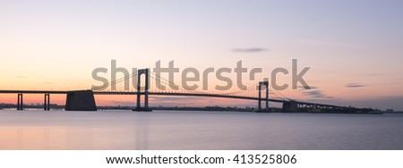 Sunset over Long Island Sound and Throgs Neck Bridge in New York City.