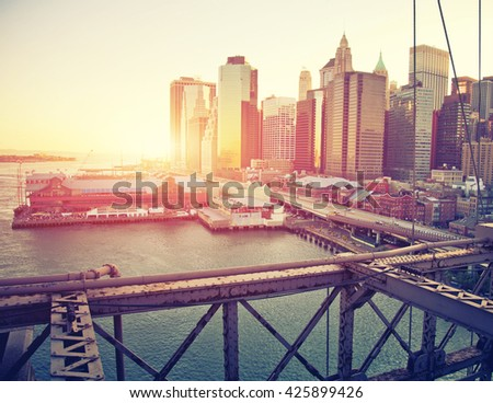 Sunset over low Manhattan from the Brooklyn Bridge - stock photo
