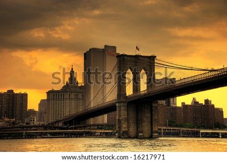 sunset over lower manhattan with brooklyn bridge - stock photo