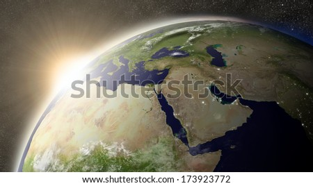 Sunset over Middle East region on planet Earth viewed from space with Moon and stars in the background. Elements of this image furnished by NASA. - stock photo