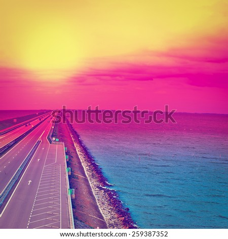 Sunset over Modern Highway on the Protective Dam in Netherlands, Instagram Effect - stock photo