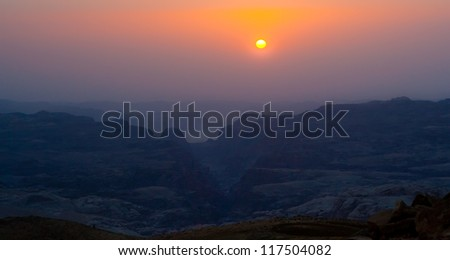 Sunset Over Mountains and Canyons