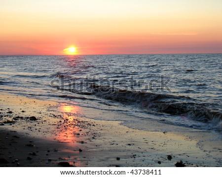 Sunset over Nova Scotia beach - stock photo