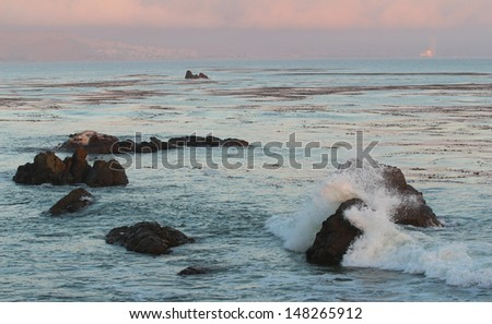 Sunset over Pacific Ocean near Morro Bay, California, USA - stock photo