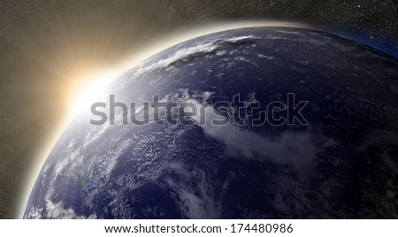 Sunset over Pacific ocean on planet Earth viewed from space with Moon and stars in the background. Elements of this image furnished by NASA. - stock photo