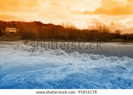 sunset over river rapids in autumn