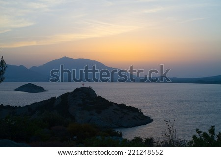 Sunset over sea and mountains in Datca, Turkey. - stock photo