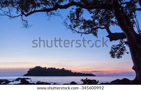 Sunset over sea beach in Thailand - stock photo