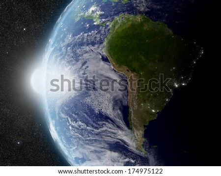 Sunset over South America region on planet Earth viewed from space with Sun and stars in the background. Elements of this image furnished by NASA. - stock photo