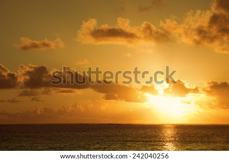 Sunset over South Pacific Ocean - Rarotonga, Cook Islands, Polynesia - stock photo