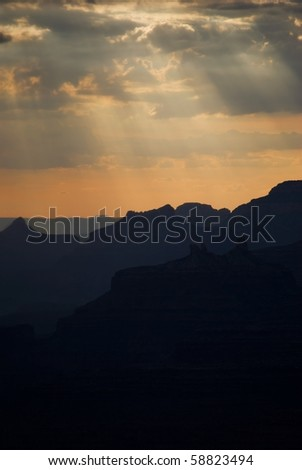 Sunset over south rim grand canyon during rainstorm