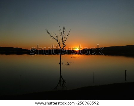 Sunset over the Alice Springs water treatment ponds - stock photo