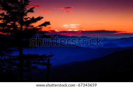 Sunset over the appalachian mountains, cascading peaks with firey sky and clouds in the Smokies - stock photo
