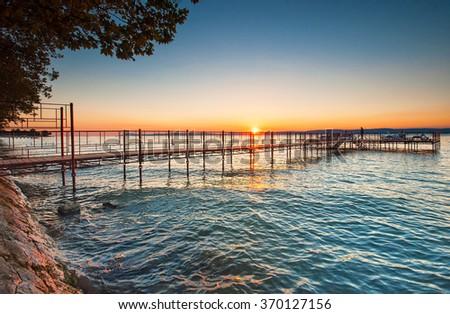 Sunset over the Balaton - stock photo