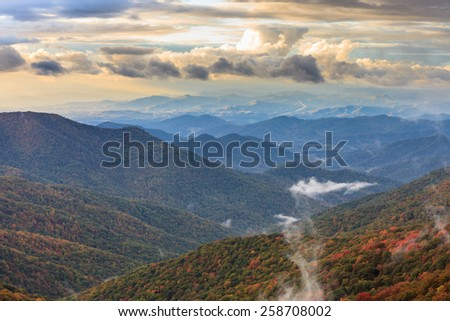 Sunset over the Blue Ridge Appalachian Mountains south of Asheville in autumn. - stock photo