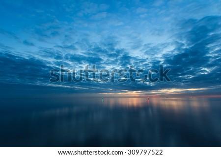 Sunset over the calm Baltic sea. Latvia. - stock photo
