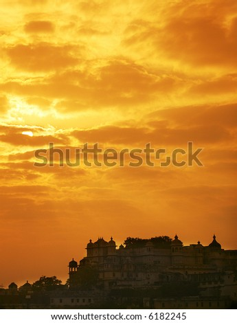 Sunset over the castle in Udaipur, Rajasthan, India - stock photo