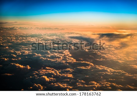 Sunset over the clouds