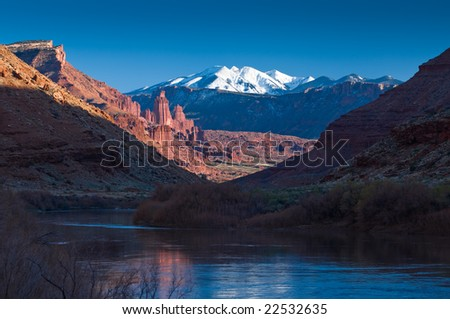 Sunset over the Colorado River and Fisher Towers near Moab, Utah - stock photo