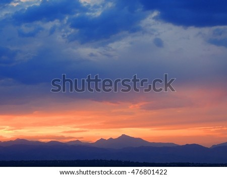 sunset over the front range of the rocky mountains as seen from broomfield, colorado