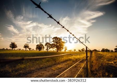 Sunset over the Hay plains in Australia - stock photo