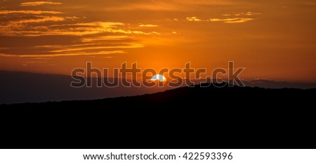 Sunset over the how - stock photo