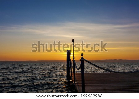 sunset over the lake - stock photo