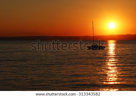 Sunset over the lake with ship