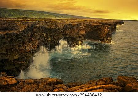 Sunset over the lava coastline of Kona Hawaii - stock photo