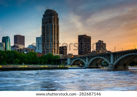 Sunset over the Minneapolis skyline and Mississippi River, in Minneapolis, Minnesota. - stock photo