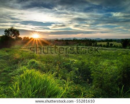 Sunset over the mountain - stock photo