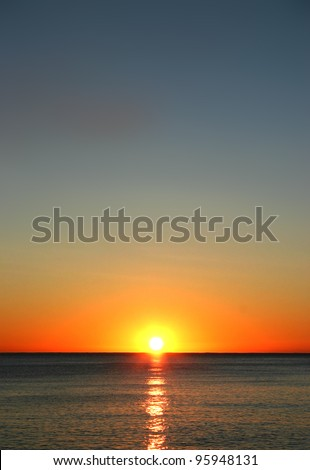 Sunset over the ocean - stock photo