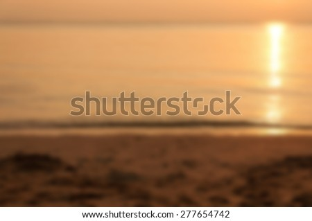Sunset over the ocean and beach - Blurred picture style