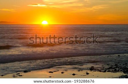 Sunset over the ocean waves landscape background - stock photo