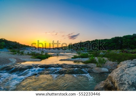 Sunset over the Pedernales River Waterfall at Pedernales State Park near Johnson City, Texas in the Texas Hill Country