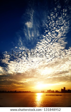 sunset over the river - stock photo
