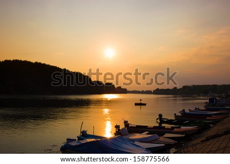Sunset over the river in the summer early evening, Beautiful Sunset on a River with Boats, photography