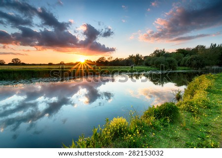Sunset over the River Stour as it flows past Wimborne in Dorset