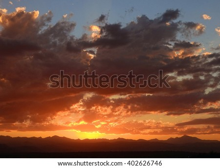 sunset over the Rocky Mountains  of colorado, as seen from Broomfield  - stock photo
